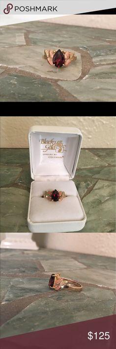 NIB Black Hills Gold and Garnet Ring This gorgeous Black Hills Gold (yellow and rose gold) and Garnet ring is NIB! Flawless. Jewelry Rings