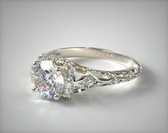 SKU 58635 - A petite filigree engagement ring with diamond accents has a very organic and feminine feel. Choose the diamond or gemstone of your choice to complete this romantic ring.
