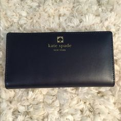 Kate Spade black/red wallet Brand NEW, never used before, NO holes and NO rips, and NO trades please. kate spade Bags Wallets