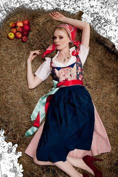 Sweet style. Dirndl combined with headband and double bow for the apron. Blue/red/dark red/light green combination. Wow.