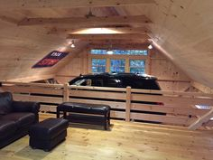 Partial loft in our 1-1/2 story barn; open to car lift bay below. www.countrycarpenters.com