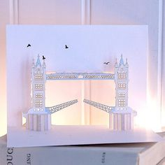 These beautifully detailled, pop-up cards, which are cut from a single piece of card using no glue, are so lovely they are far more than just a card - a beautiful small gift. The originals were designed and handcut by a master in paper engineering and then reproduced using laser cutting technology. We put some white fairy lights behind them to light up the windows - magical!
