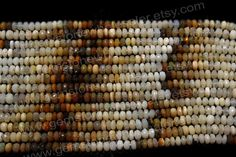 Ethiopian Opal Faceted Roundel Quality B / by GemstoneWholesaler
