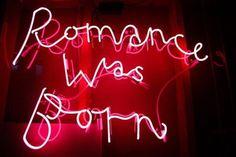 romance was born neon sign