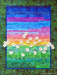 Strip applique landscape in summer fun colors with 2 dimensional leaves.