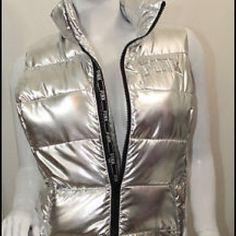 VS PINK FASHION SHOW VEST NWT This fashion show piece is metallic silver with pink logo on zipper seam, front and the back collar very light weight perfect for any season PINK Victoria's Secret Jackets & Coats Vests