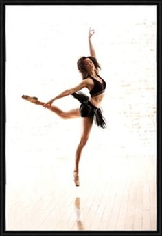 Ballet dancer jumping in black tutu print by Phil Payne Photography at Photos.com 142957169