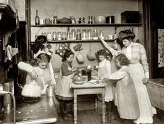 Cooking became a family affair, as we see in this 1915 photo. But only if you were female!