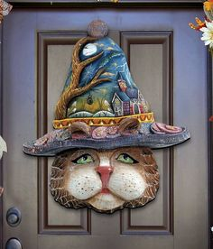 The Holiday Aisle Halloween Eve Cat Hanging Figurine Wood Door Hanger Wall Decor The Holiday Aisle This door hanger is inspired by the well renowned G. DeBrekht Artistic Studio's Iconic Holiday Masterpiece collection. It is handcrafted from. Halloween Eve, Rustic Halloween, Halloween Porch Decorations, Outdoor Halloween, Happy Halloween, Halloween Projects, Holiday Decorations, Halloween Themes, Country Fall Decor