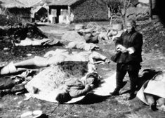 On February 5, 1938, A Chinese woman surveys the remains of her family, all of whom met death during Japanese occupation of Nanking, allegedly victims of atrocities at the hands of Japanese soldiers