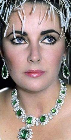 Elizabeth Taylor wearing her emerald and diamond jewelry.