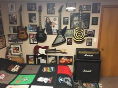 My whole music wall including all my electric guitars amp pedals and musician autographs.