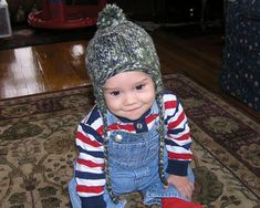 A quick and easy earflap hat pattern for babies and toddlers that can be easily changed to suite your own taste. Knit with edge and earflaps in garter stitch or seed stitch, change the i-cord ties to braided ties, omit the pom-pom, or add a crochet edge.