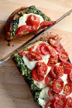 Bruschetta con Pesto, Pomodorini e Burrata - Preheat the oven to 350 degrees. Coat one half loaf Italian or Ciabatta bread with olive oil, then rub with a cut garlic clove. Bake until light golden brown. Remove from oven and top with your favorite pesto, sliced burrata cheese and cherry tomatoes. Bake until cheese is melted and tomatoes are slightly roasted. Slice and serve.