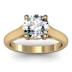 Petite Solitaire Engagement Ring set in 18k Yellow Gold  Petite Solitaire Engagement Ring set in 18k Yellow Gold
