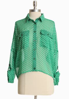 "Falling Softly Polka Dot Blouse 36.99 at shopruche.com. This playful green top stars a cheerful ivory polka dot print, chic dolman roll tab sleeves, and front button closures. Finished with front pockets and an asymmetrical hem.100% Polyester, Imported, Length from top of shoulders 20.5"" (front), 25"" (back), ,"