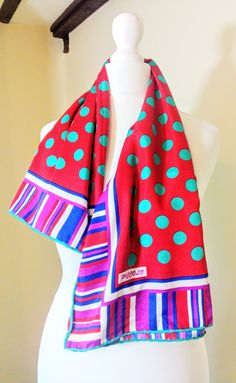 A beautiful designer silk scarf by Piccolo of Italy. It is a lovely vibrant scarf with a polka dot design in red, pink, blue and green. The scarf has hand rolled edges and is large enough to wear as a shawl. It is in very good condition with only a few light marks and a couple of tiny pin holes. Size 35(89cm) x 35(89cm). Please take a look at the rest of my shop for more gorgeous vintage treasures: https://www.etsy.com/uk/shop/MollyTops I am happy to combine or reduc...