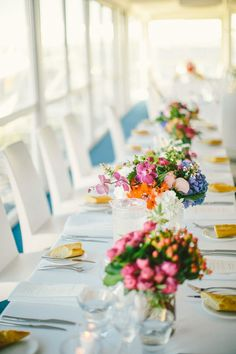 The colors in this shot are so beautiful!! Centerpiece | See the wedding on SMP: http://www.StyleMePretty.com/australia-weddings/2014/03/10/perth-wedding-at-acqua-viva/ Photography: Natasja Kremers