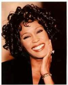 """Whitney Houston--I like this picture. I think it's from the """"I'm Every Woman Video."""" She looks so happy here. She had such a beautiful smile."""