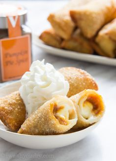These Pumpkin Cheesecake Egg Rolls are the perfect combination between pumpkin pie and cheesecake, all wrapped up and fried until golden brown. It's basically State Fair food all jacked up on pumpk...