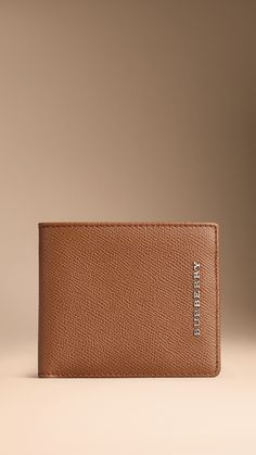 fe2c9b27938c Folding wallet in refined London leather. Find the perfect gift this  festive season at Burberry