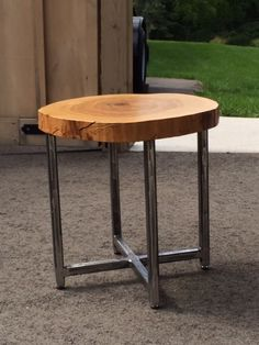 Wood Slice Table - Our neighbours cut down an old tree - we salvaged the wood, cut it into slices and are making these side tables. The wood is ash, with a hard urethane finish, with metal legs.  We removed the bark so it is usable both indoors and outdoors.