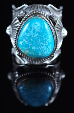 Handmade ring, with natural rare gem grade Fox Turquoise, by Navajo artist Andy Cadman.
