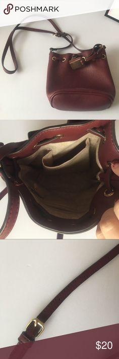 Maroon Bucket Purse Maroon or dark red Bucket Purse. Used only twice with adjustable strap. Super cute! 💋15% off all bundles💄 Charming Charlie Bags
