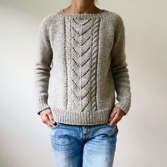 This super basic pullover is all about one simple detail: the wide cable and lace panel falling down the front. Since it's worked in an aran to chunky weight yarn, the lace looks modern and the sweater knits up in no time! Find this pattern and more knit
