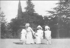 Empress Alexandra playing with her daughters in the park: 1902.