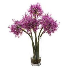 Silk allium arrangement in a glass vase. Made in the USA.     Product: Faux floral arrangementConstruction Material: Silk and glassColor: PurpleFeatures: Includes starfire alliumsDimensions: 25 H x 19 Diameter