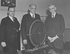 Photo three of three. John T. Morris, Victor Beam and Tesla pose with the alternator that had been discovered.