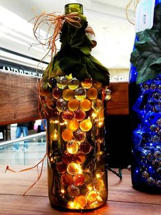 how to make wine bottle into decorative light vase...I love the grape design on the outside of bottle!