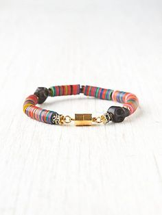 Multicolor Beaded Skull Bracelet  The colors are a little Bohemian and the skulls add an edge! LOVE!!