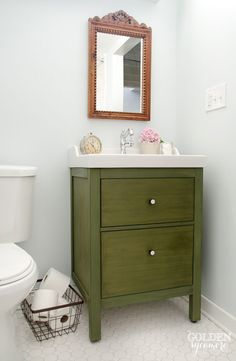 Ikea bathroom vanity turned antique looking one-of-a-kind piece with milk paint