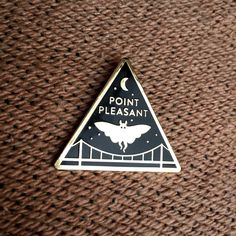 This hard enamel pin features the Mothman over the Silver Bridge. Head over to Fauna Obscura and check out our collection of cryptid inspired enamel pins and patches! Adventure Aesthetic, Mothman, Cryptozoology, Friend Birthday Gifts, Hard Enamel Pin, Pin And Patches, Cute Pins, Lapel Pins, Im Not Perfect
