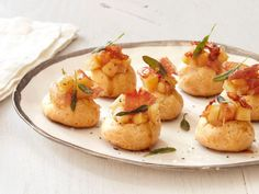 White Cheddar Gougeres with Apple Filling, Prosciutto and Sage : Small in size but big in flavor, these cheese puffs combine savory and sweet ingredients, including prosciutto, sage and warm spiced apples.