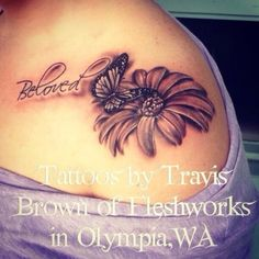 Black and grey butterfly on a flower by Travis Brown #InkedMagazine #blackandgrey #butterfly #flower #tattoo #tattoos #Inked #Ink