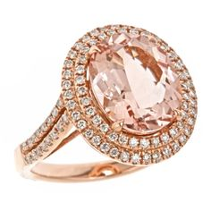 14k rose gold ring featuring morganite center stone encircled and paved down the shank by natural white diamonds.