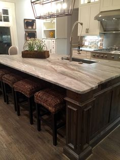 Transitional farmhouse with Leathered granite, fantasy brown color, stained island with white kitchen