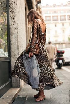 Head to toe leopard print doesn't have to scream 'tacky'. This flowy look has an earthy, bohemian vibe to it and is complemented by understated, simple accessories.