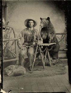 ca. 1860-80's, [tintype portrait of a hunter and his dog, both sitting with a taxidermied bear looming menacingly behind]