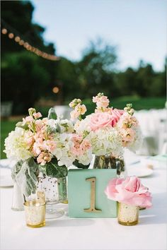 mint pink and peach centerpiece and mint and gold table numbers / http://www.himisspuff.com/peach-mint-wedding-color-ideas/3/