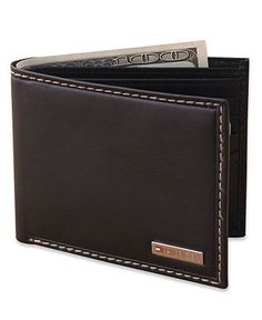 This ultra-casual wallet from Tommy Hilfiger has a streamlined design for easy carrying. | Leather | Imported | Bifold passcase wallet from Tommy Hilfiger | Tommy Hilfiger logo tag on front | ID holde