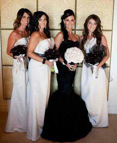 Black wedding dress with a white flower boutiq so beautiful