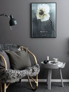 Dark grey walls in a reading corner in a Swedish space