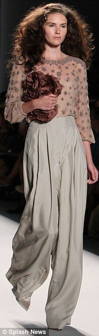 6cafcdb9b1 High-wasted wide-leg silk pants paired with a delicately beaded top was a