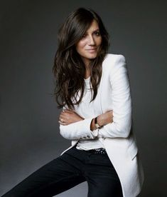 White blazer for work! Women wearing a long white blazer with black slacks, business casual!