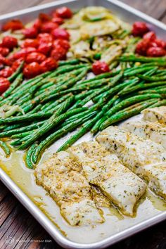 One Pan Baked Wild Halibut | The Mediterranean Dish. Halibut fillet with green beans and cherry tomatoes baked in a delicious Mediterranean sauce with garlic, olive oil and fresh lemon juice.
