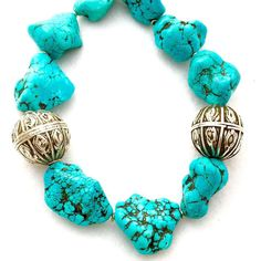 Turquoise is December's stone. Make a bold and bright statement this month with chunky hunks of this beautiful stone! Here it is styled with lovely old antique Yemeni silver beads, made by Jewish silversmiths.